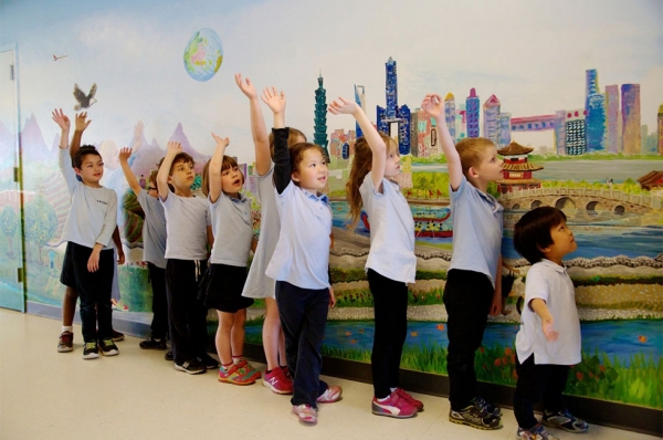 "Local and Chinese scenery are combined in volunteer-painted ""We Are Yinghua,"" a mural funded through the Metropolitan Regional Arts Council. (Erin Spector/Yiinghua Academy)"