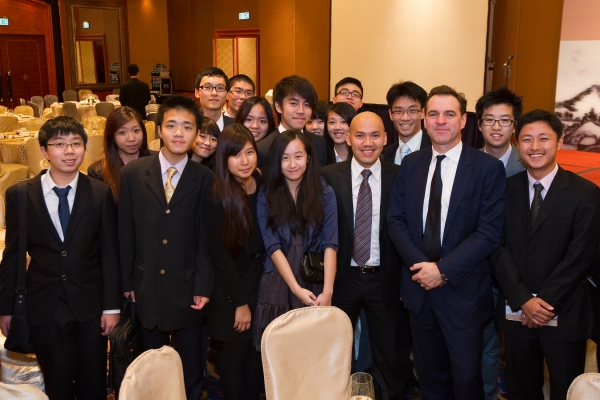 Ferguson poses with a group of local students who attended the dinner. (Asia Society Hong Kong Center)