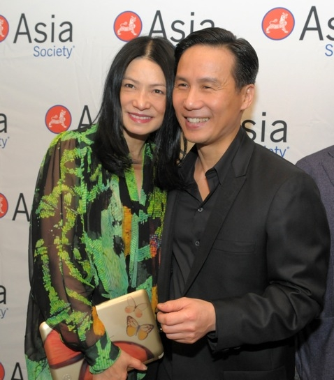 Vivienne Tam, shown holding her trademark HP butterfly clutch, with actor BD Wong. (Elsa Ruiz/Asia Society)