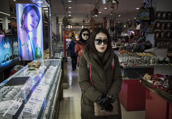Chinese shoppers walk through a small department store in a shopping district in central Beijing, China. (Kevin Frayer/Getty Images)