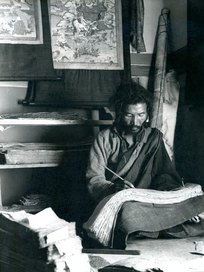 "Scribe writing in Gyantse, Tsang, Tibet. (F. Maraini, 1937; 37/2434. Courtesy of the Museum of Civilisation-Museum of Oriental Art ""Giuseppe Tucci,"" Rome.)"