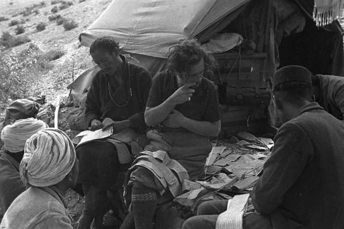 Giuseppe Tucci reorganizing the scattered pages of several manuscripts at his camp, Miang, Ngari, Tibet. (Eugenio Ghersi, 1933; Neg. dep. 6037/28. Courtesy of Istituto Italiano per l'Africa e l'Oriente (Is.I.A.O.) in l.c.a. and Ministero Degli Affari Esteri e della Cooperazione Internazionale.)