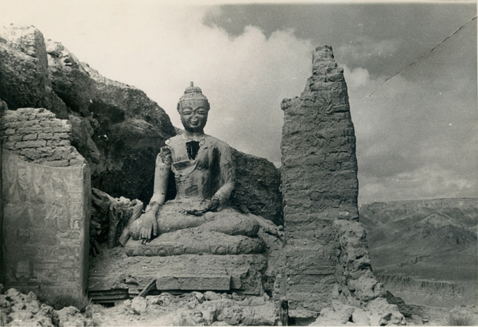 "Buddha in the ruins with murals, Khardzong, Usukhar, Ngari, Tibet. (Eugenio Ghersi, 1935; P-3227. Courtesy of the Museum of Civilisation-Museum of Oriental Art ""Giuseppe Tucci,"" Rome.)"