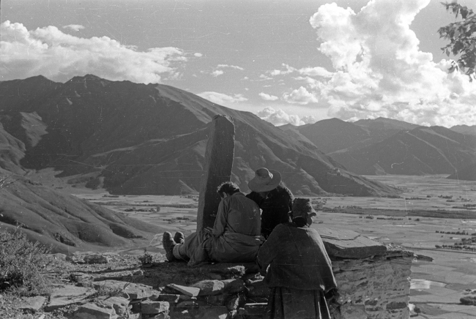 Tucci copying inscriptions from a stone pillar (rdo ring) at an unidentified location, possibly in U, Tibet. (Anonymous, 1948; Neg. dep. 8047/15. Courtesy of Istituto Italiano per l'Africa e l'Oriente (Is.I.A.O.) in l.c.a. and Ministero Degli Affari Esteri e della Cooperazione Internazionale.)