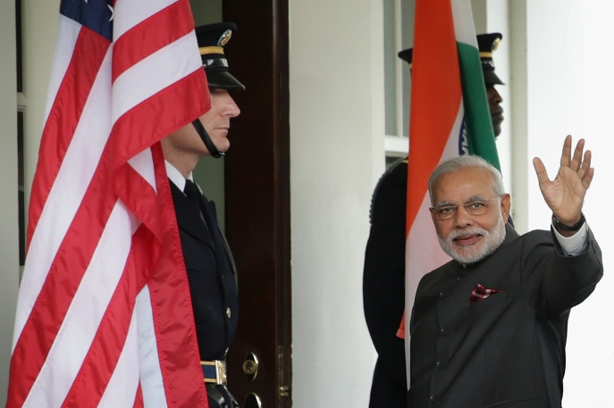 Indian Prime Minister Narendra Modi waves as he arrives outside the West Wing of the White House for an Oval Office meeting with U.S. President Barack Obama September 30, 2014.