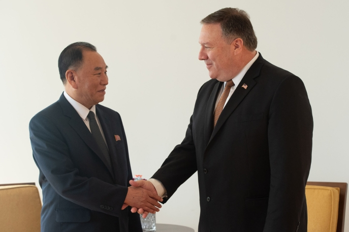 Kim Yong Chol (L) shakes hands with Mike Pompeo