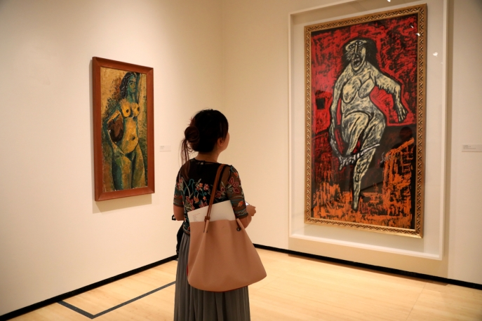 A visitor viewing 'The Progressive Revolution: Modern Art for a New India' at Asia Society New York