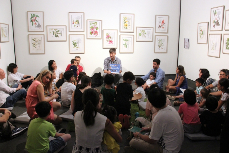 James Prosek reading his book Bird, Butterfly, Eel to families in the Chantal Miller Gallery, where Sally Grace Bunker's botanical drawings are on view.