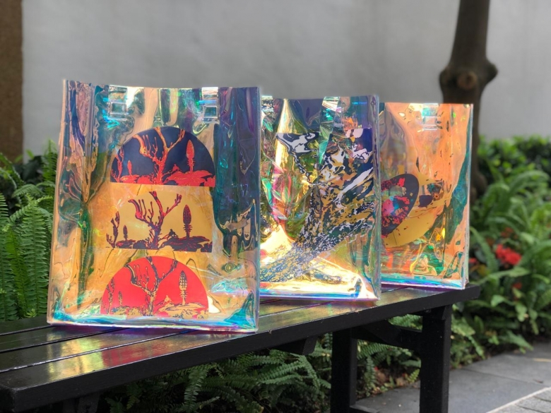 Three bags decorated with Vvzela Kook's colorfuk paintings
