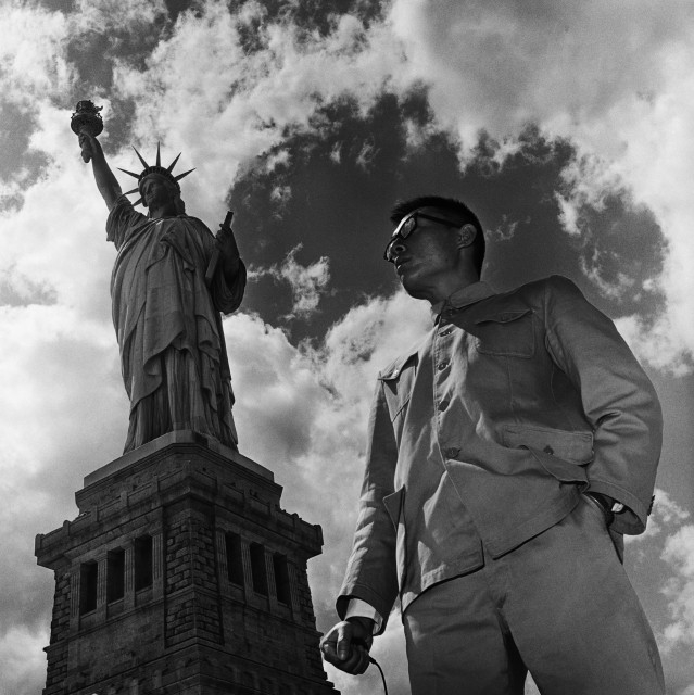 Tseng Kwong Chi. New York, New York 1979 (Statue Of Liberty) From The East Meets West Self-Portrait Series 1979–1989 1979. Hong Kong. Selenium-toned gelatin silver print.H. 20 x W. 16 in. (50.8 x 40.6 cm) Asia Society, New York: Gift of Mitch and Joleen Julis, 2015.15